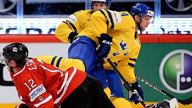 Alex Edler of Sweden, left, gets his knee up, injuring Canadian Eric Staal at the most recent world championships.