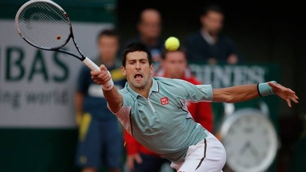 Serbia's Novak Djokovic returns against David Goffin of Belgium during their first round match at the French Open tennis tournament at Roland Garros stadium on Tuesday.