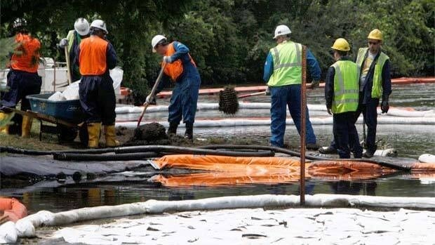 Crews in Marshall Township, Mich., clean up oil from the Enbridge pipeline leak in July 2010.