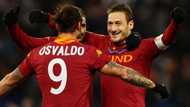 Pablo Daniel Osvaldo of Roma celebrates with teammate Francesco Totti after scoring against Fiorentina at Stadio Olimpico on December 8, 2012 in Rome, Italy.