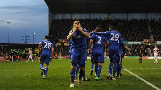 Frank Lampard of Chelsea celebrates scoring a penalty during the Barclays Premier League match between Stoke City and Chelsea at the Britannia Stadium on Saturday in Stoke-on-Trent, England.