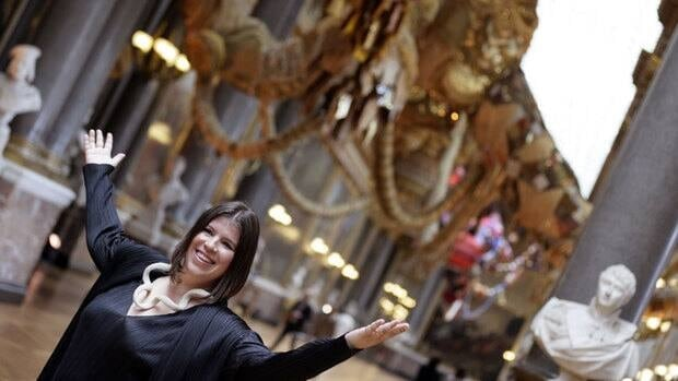 Portuguese contemporary artist Joana Vasconcelos helped unveil her exhibit at the Palace of Versailles on Monday.