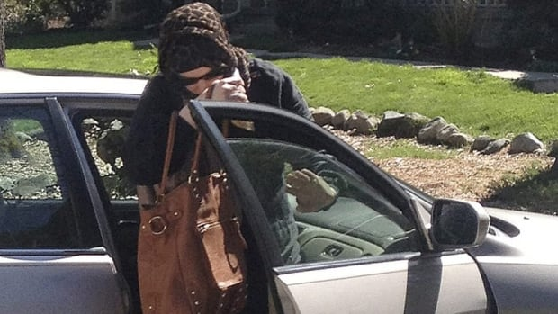 Katherine Russell Tsarnaeva, wife of killed Boston Marathon bombing suspect Tamerlan Tsarnaev, exits a car at the home of her parents in North Kingstown, R.I., on April 21.