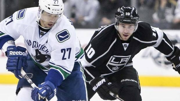 Manny Malhotra, left, and the Canucks open the playoffs against Mike Richards, right, and the Kings. The teams split their four-game season series, with Vancouver taking the final meeting 1-0 at home on March 26, but Los Angeles outscored its opponent 9-7 overall.