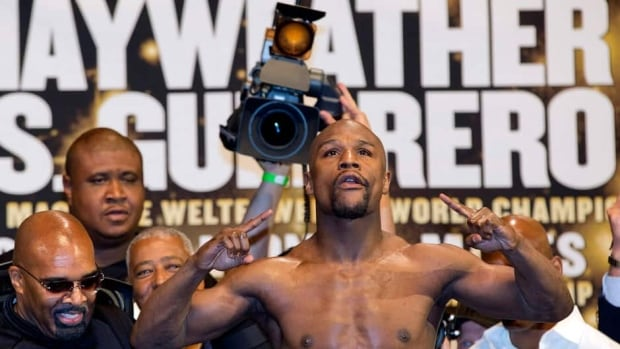 Floyd Mayweather Jr. weighed in at 146 pounds for his WBC world welterweight championship defence Saturday against Robert Guerrero.