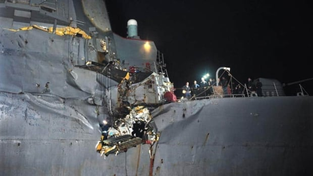 No one was injured and no oil was spilled, say officials, after a U.S. navy destroyer collided with a Japanese-owned tanker in the Strait of Hormuz.