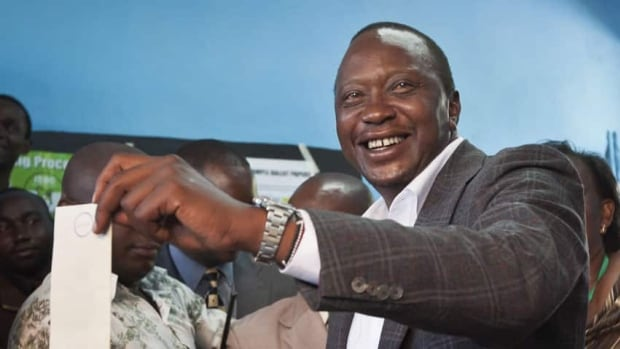 Controversial candidate Uhuru Kenyatta, here casting his own ballot, won Kenya's presidential election after winning just over 50 per cent of the vote.