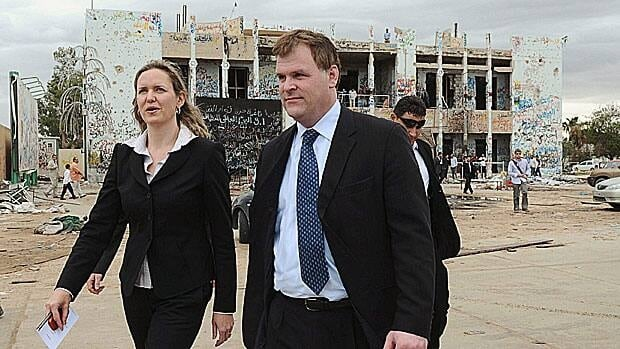 Foreign Affairs Minister John Baird and then-Ambassador to Libya Sandra McCardell visit the former fortified compound of Moammar Gadhafi in Tripoli, Libya, on Oct. 11, 2011. McCardell is back in Canada awaiting her next posting.