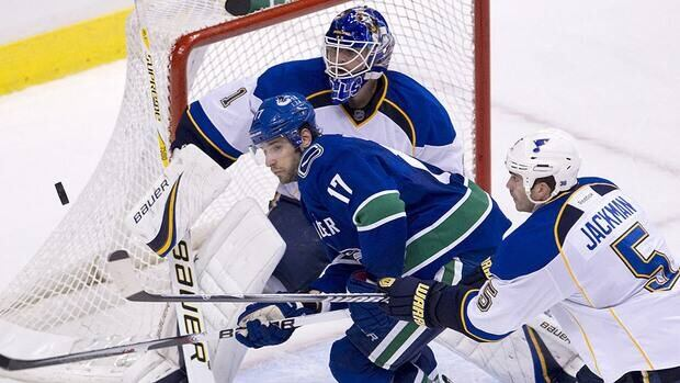 Vancouver forward Ryan Kesler and St. Louis defender Barret Jackman battle in front of Blues goalie Brian Elliott the last time the teams played at Rogers Arena.