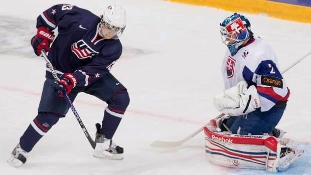 U.S. forward John Gaudreau, left, scores on Slovakia goalie Adam Nagy during the first period in Ufa, Russia on Monday.
