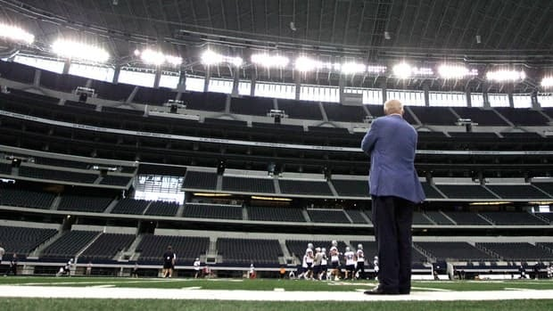 Dallas Cowboys owner Jerry Jones watches his team from the sidelines during NFL football practice at Cowboys Stadium, in May in Arlington, Texas. The team was recently valued at $2.1 billion US by Forbes.