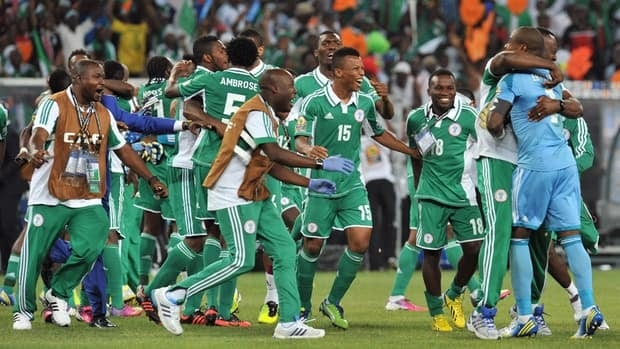 Nigeria's national football team players celebrate after they won the 2013 African Cup of Nations final against Burkina Faso on Sunday at Soccer City stadium in Johannesburg.