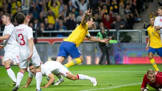 Sweden's Zlatan Ibrahimovic reacts after scoring the opening goal during the friendly soccer match against England.