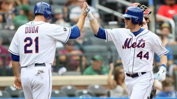 Jason Bay, right, celebrates a home run with the New York Mets in September. Bay finalized a one-year contract with the Seattle Mariners on Saturday.