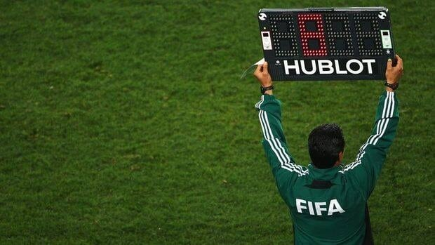 A FIFA match official holds up an electronic board to signal a substitution during the 2010 FIFA World Cup South Africa Quarter Final match between Paraguay and Spain at Ellis Park Stadium on July 3, 2010 in Johannesburg, South Africa.