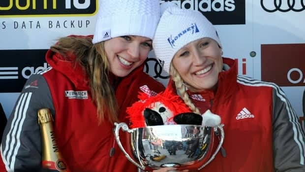 Canada's Kaillie Humphries, right, and brakeman Chelsea Valois celebrate after winning the world championship on Saturday after beating the field by nearly seven-tenths of a second.