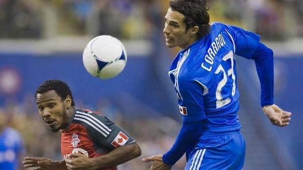 Montreal Impact's Bernardo Corradi, right, moves the ball ahead in front of Toronto FC's Julian de Guzman the first half of their game on Saturday. Montreal won for the first time at home in its expansion season.