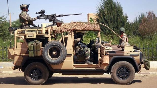 French special forces drive through the city of Gao in northern Mali. Islamist extremists fled the city Saturday after French, Chadian and Nigerien troops arrived, ending 10 months of radical Islamic control over the city.