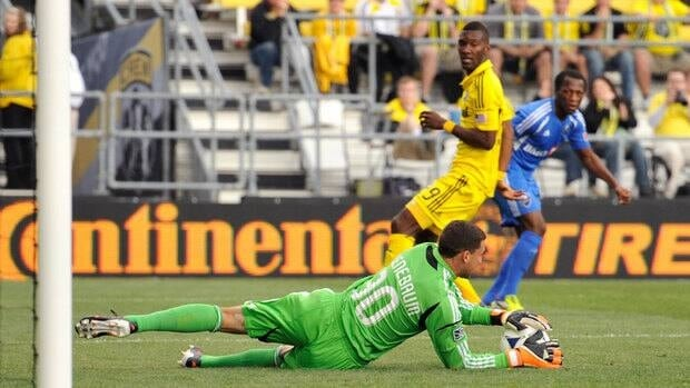 Colulmbus Crew goaltender Andy Gruenebaum makes a save against the Montreal Impact, leading his team to a 2-0 win.