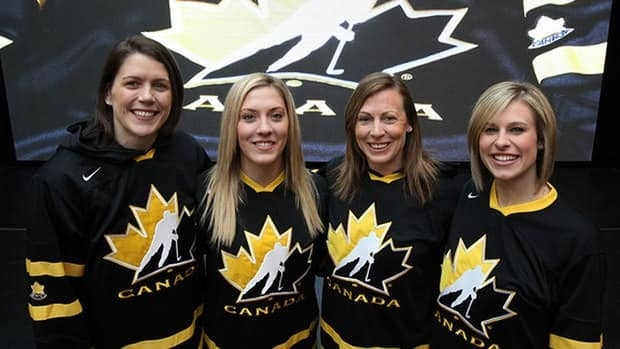 Nike Team Livestrong ambassador Tessa Bonhomme, far right, is joined by Canadian women's hockey squad teammates, from left, Gillian Apps, Meghan Agosta-Marciano and Jayna Hefford at the official unveiling of the Livestrong Team Canada jersey.