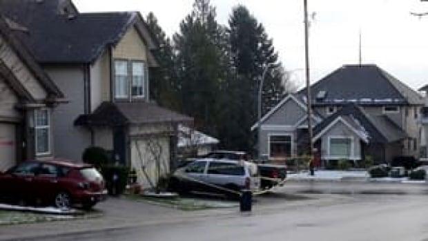 hi-bc-121231-langley-homicide-police-tape-burritt-4col