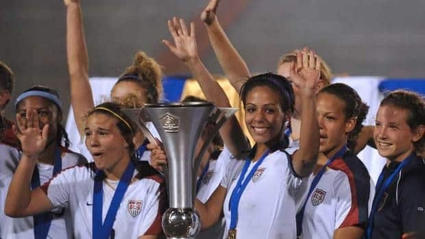 Sydney Leroux, centre, of the USA team holds the trophy of CONCACAF champion after winning the U-20 women final soccer match on January 30, 2010 in Guatemala City. Leroux has earned a spot on the U.S. olympic qualifying team this year.