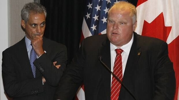 Chicago Mayor Rahm Emanuel listens to Toronto Mayor Rob Ford, shortly before the pair signed a new sister cities agreement on Wednesday, Sept. 19, 2012.