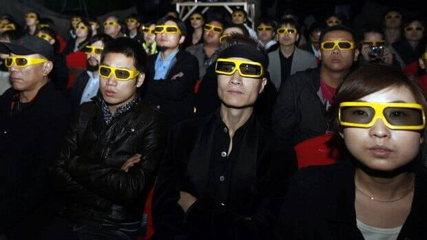 A Beijing audience watchs a movie trailer of the 3D film Empires of the Deep in 2010. Chinese officials have announced a new fund for co-financing Hollywood movies.