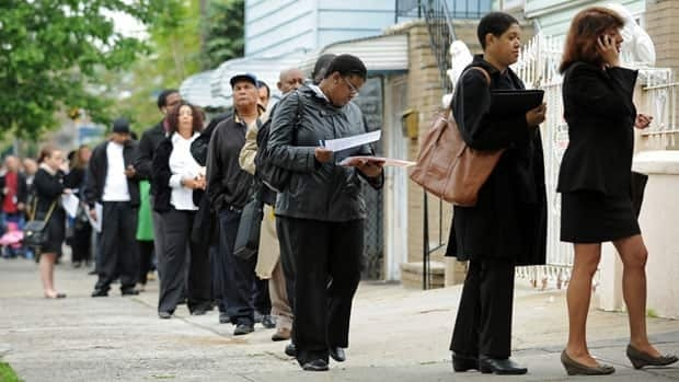 Job seekers line up for an employment fair in New York in May. New claims for US unemployment benefits fell last week to the fewest since February 2008.