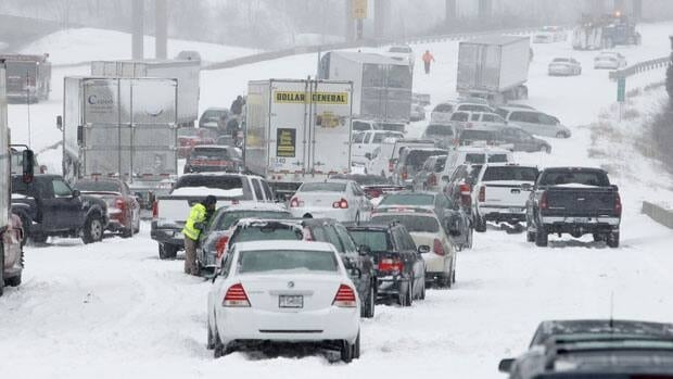 Stranded vehicles litter northbound I-29 in Kansas city after the area was pounded with rapidly accumulating snow.