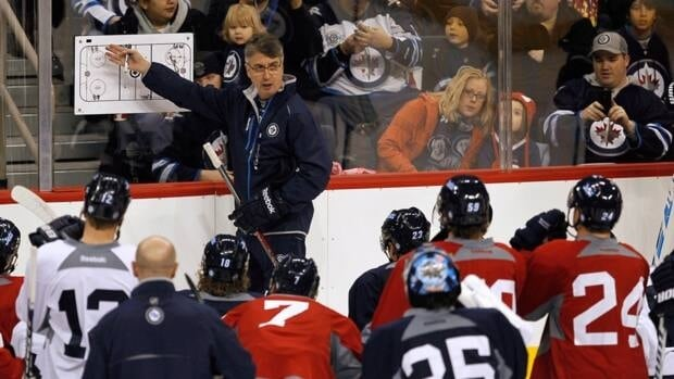 Winnipeg Jets' head coach Claude Noel talks to the players on the opening day of training camp in Winnipeg on Sunday.