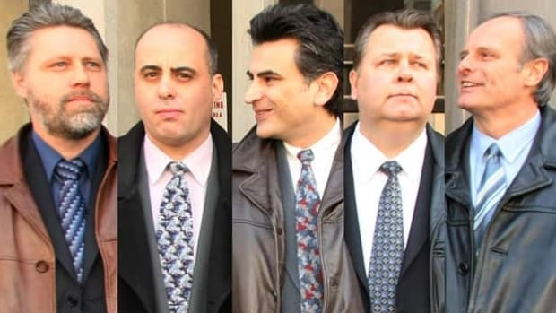 An Ontario judge has sentenced five members of the Toronto Police Service drug squad begins to 45 days of house arrest in what had been the largest police corruption case in Canadian history. From left to right are Ray Pollard, Steven Correia, Ned Maodus, Joe Miched and John Schertzer.