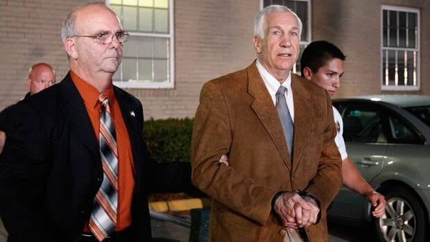 Former Penn State assistant football coach Jerry Sandusky leaves the Centre County Courthouse in handcuffs after a jury found him guilty in his sex abuse trial on June 22, 2012 in Bellefonte, Pennsylvania.
