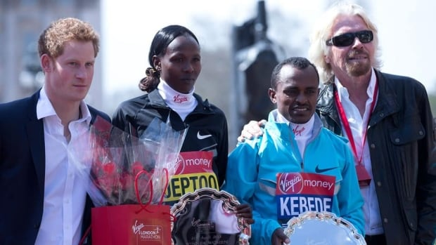 Tsegaye Kebede of Ethiopia, second right, winner of the men's marathon, Priscah Jeptoo of Kenya, second left, winner of the women's marathon with Britain's Prince Harry, left, and British businessman Richard Branson, right, pose together in London on Sunday.