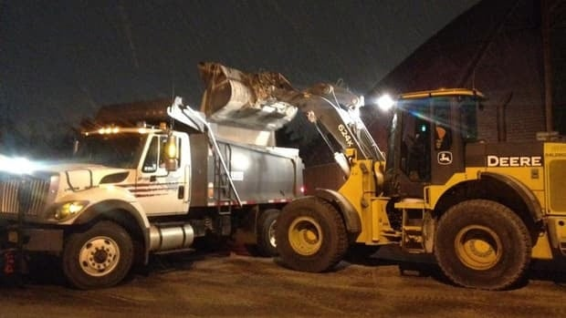 Salt trucks fill up at the Halifax Regional Municipality depot in Burnside on Tuesday morning.