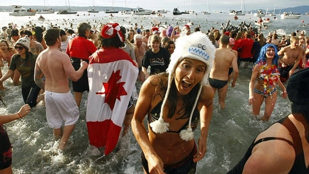 British Columbians, shown running into English Bay during the annual Polar Bear Swim in Vancouver, are among those Canadians with the highest quality of life, according to a new study comparing the country's provinces and territories.