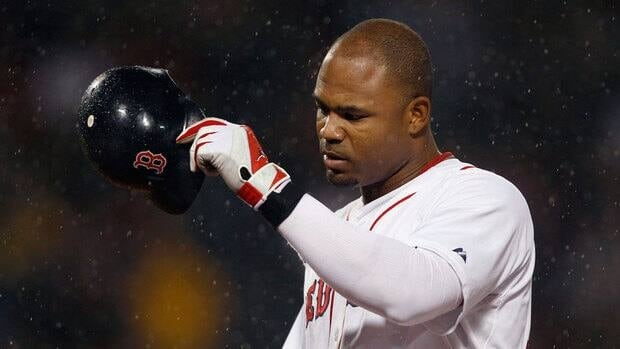 The Boston Red Sox's Carl Crawford, shown in this 2011 file photo, alleges he was the target of a racial slur by a fan in New Hampshire.