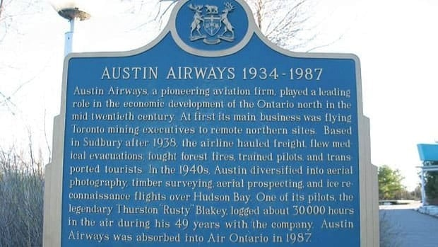 An Ontario historical plaque for Austin Airways sits on the grounds of Science North in Sudbury.