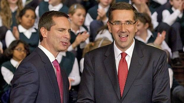 Ontario cabinet minister John Milloy (right) stands with Premier Dalton McGuinty at Queen's Park in Toronto in October 2011. Milloy announced on Thursday the provincial government will provide Ontario municipalities with $42 million in one-time funding to offset cuts to anti-poverty programs.