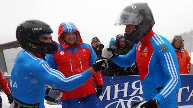 Alexei Negodaylo, left, and Alexander Zubkov of Russia 1 celebrate their victory at Bobbahn Winterberg on December 9, 2012 in Winterberg, Germany.