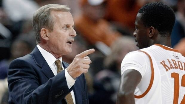 Texas Longhorns coach Rick Barnes, left, talks with Canadian guard Myck Kabongo in this file photo from December, 2011.