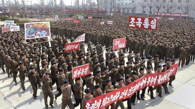 North Koreans attend a rally held to gather their willingness for a victory in a possible war against the U.S. and South Korea in Nampo, North Korea, on April 3.