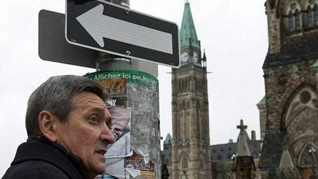 Senator Raymond Lavigne heads toward Parliament Hill after being found guilty of fraud and breach of trust charges on March 11,2011.