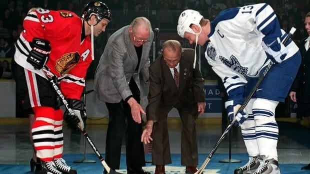 In this 1999 file photo, former teammates Doug Gilmour, left, and Mats Sundin, right, take the ceremonial face off during the final game at Maple Leafs Gardens. On Tuesday, it was announced that Sundin will follow Gilmour into the Hockey Hall of Fame and Gilmour took to Twitter to give his congratulations.