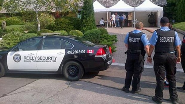 A scene from the 2012 Ford Fest shows private security guards outside the mayor's Etobicoke home. This year the barbeque relocated to Scarborough.