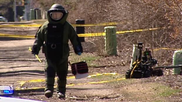 A bomb disposal expert returns with the remains of a suspicious package which turned out to be a prize in an online high-tech scavenger hunt.