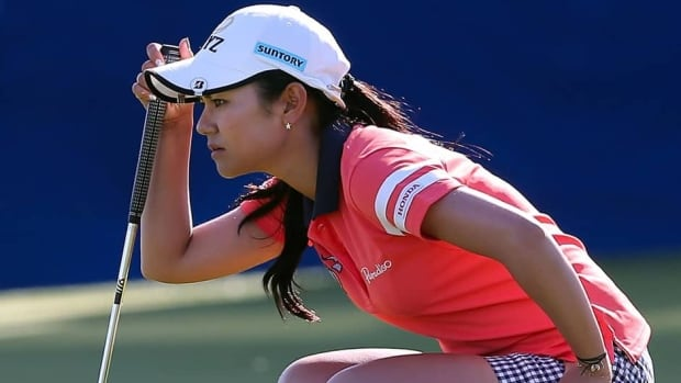 Ai Miyazato of Japan lines up her putt on the 18th hole green during the third round of the RR Donnelley LPGA Founders Cup at Wildfire Golf Club in Phoenix, Arizona.