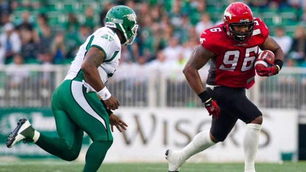 Saskatchewan Roughriders quarterback Darian Durant runs down Calgary Stampeders defensive lineman Demonte' Bolden after grabbing an interception in the first quarter of pre-season action Thursday.