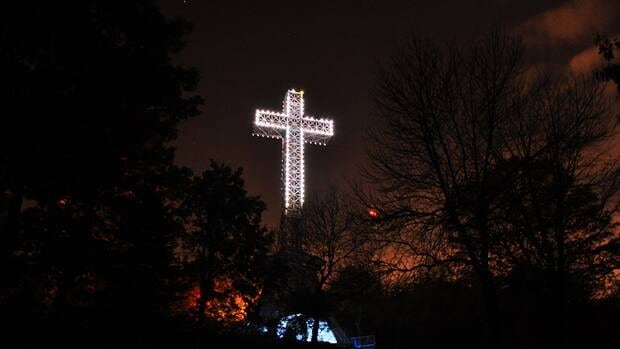 The cross atop Mount Royal will remain white as Pope Benedict takes his exit.