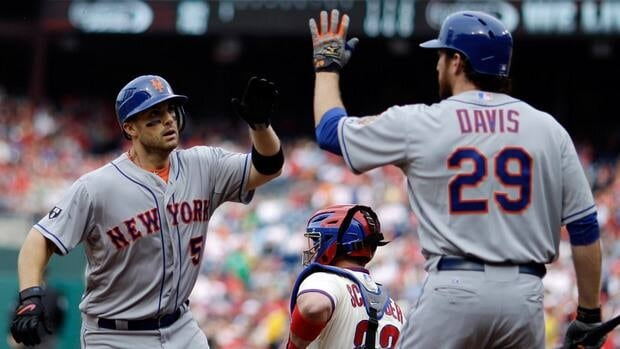 New York Mets' David Wright, left, and Ike Davis celebrate after Wright's home run in the first inning.